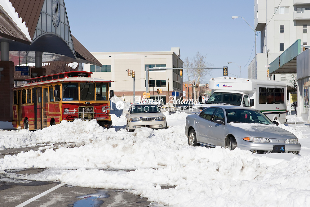 Cars, trucks and city busses are left abandoned on Hudson Ave at NW 4th Street in downtown Oklahoma City, Okla. on Friday, Dec. 25, 2009 following the Christmas Eve 2009 Blizzard.  Oklahoma City ended with a record snowfall of 14.1 inches.  (Photo by Alonzo J. Adams)