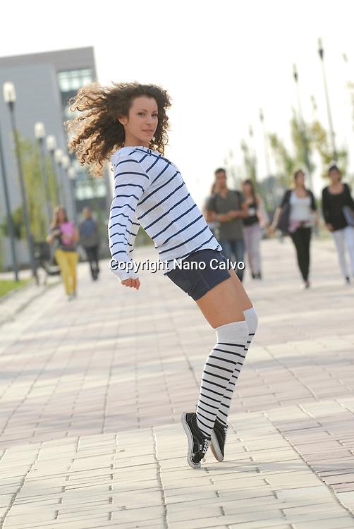 Cute teen dancer doing a street dance movement