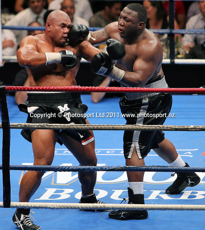 David Tua and King exchange punches. David Tua v Demitrice King. Backyard Brawl. TelstraClear Pacific Events Centre, Auckland, New Zealand. Saturday 19th March 2011. Photo: Anthony Au-Yeung / photosport