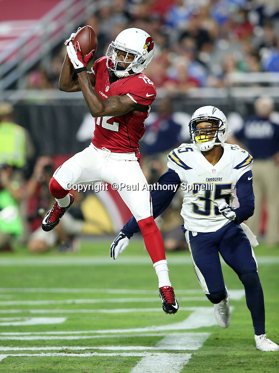 Arizona Cardinals wide receiver John Brown (12) leaps and catches a first quarter touchdown pass that gives the Cardinals a 6-0 lead while covered by San Diego Chargers cornerback Richard Crawford (35) during the 2015 NFL preseason football game against the San Diego Chargers on Saturday, Aug. 22, 2015 in Glendale, Ariz. The Chargers won the game 22-19. (©Paul Anthony Spinelli)