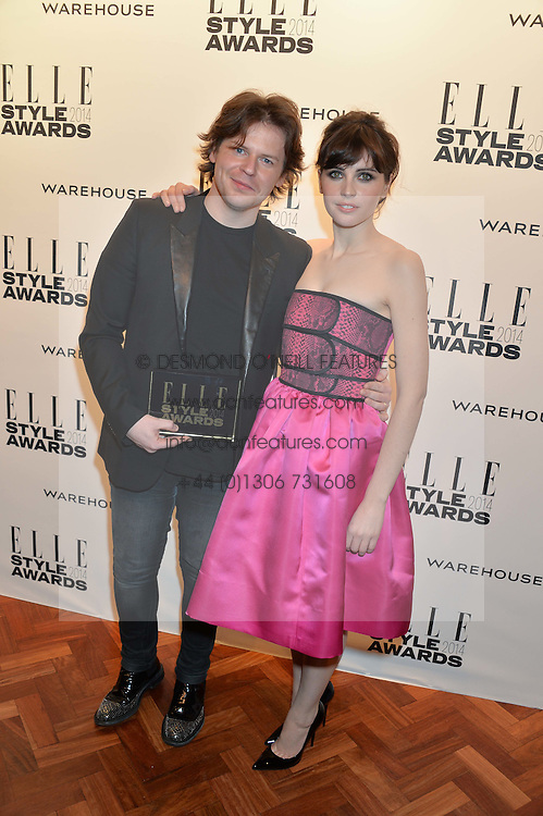 CHRISTOPHER KANE winner of the Elle British Designer of the year Award and FELICITY JONES at the 17th Elle Style Awards 2014 in association with Warehouse held at One Embankment, 8 Victoria Embankment, London on 18th February 2014.