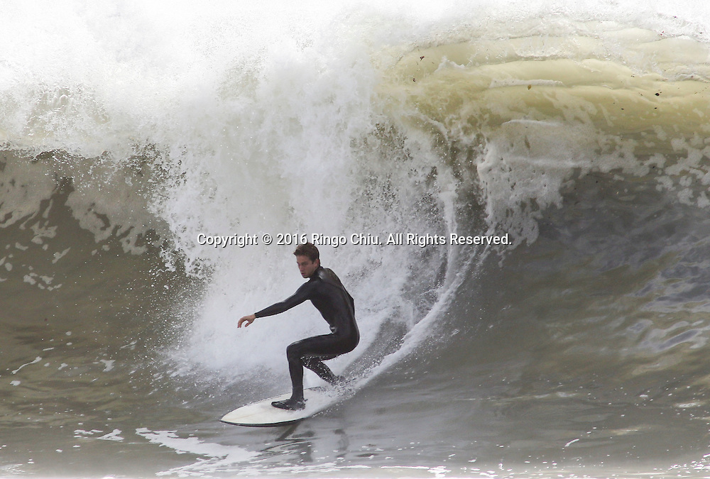 A surfer rides a wave in Seal Beach, California, Thursday, January 7, 2016. Another powerful El Ni&ntilde;o storm brought high surf warnings to parts of the Southern California coast  today.(Photo by Ringo Chiu/PHOTOFORMULA.com)<br /> <br /> Usage Notes: This content is intended for editorial use only. For other uses, additional clearances may be required.