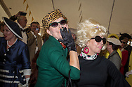 Women take part in a period dress contest at the Goodwood Revival in Chichester, England   Friday, Sept. 9, 2016 The historic motor racing festival celebrates the mid-20th-century golden era of the racing circuit and recreates the atmosphere from the 1950s and 1960s.(Elizabeth Dalziel)