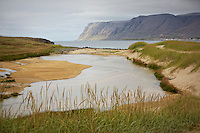 This is a photo of Breiðavik Beach, located in Western Iceland.  In the distance you can see Látrabjarg cliff, which is famous for its bird life.