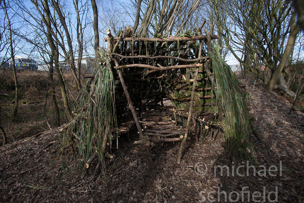 Kevin Langan with his hut on the wasteground near Ibrox. He has set himself the challenge of building 100 small huts on any land where they can be made from the natural resources.
