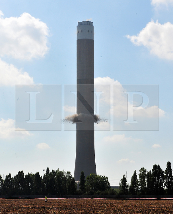 &copy; Licensed to London News Pictures. 07/09/2016<br /> Frame 2<br /> Grain Power Station chimney demolition in Kent.<br /> <br /> One of the country's tallest structures has been demolished this morning at 11am.<br />  The Power Station chimney is 244m (801 ft) which makes it taller than Canary Wharf in London. <br /> <br />  The demolition is a British record for the tallest concrete structure to be blown up!<br /> <br /> <br /> <br /> (Byline:Grant Falvey/LNP)