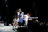 A Tribe called Quest with .Q - Tip (khaki green camouflage pants ), .Phife Dawg (towel on head and light blue shirt) and Jarobi White(white t-shirt)  performing at Nikon at Jones Beach Amphitheater for 'Rock The Bells' 2008 on August 3, 2008. . Rock The Bells