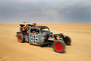 epa04412958 A modified 1941 Ford rat-rod pickup truck drives across the Hakskeenpan during the 2014 Kalahari Desert Speedweek at Hakskeenpan, Northern Cape of South Africa, 23 September 2014. The Speedweek sees motorsport enthusiasts gathering in a remote desert in the north of the country to drive their vehicles across seven kilometers of specially prepared clay track for high speed top end runs. Technically the desert Speedweek is more challenging than asphalt runs requiring much more driving and engineering skills for top honours in each class. Hakskeenpan, in the Northern Cape of South Africa close to the Namibian border is where the British Bloodhound rocket powered car will attempt to set the new world land speed record of 1610km/h in 2015.  EPA/NIC BOTHMA