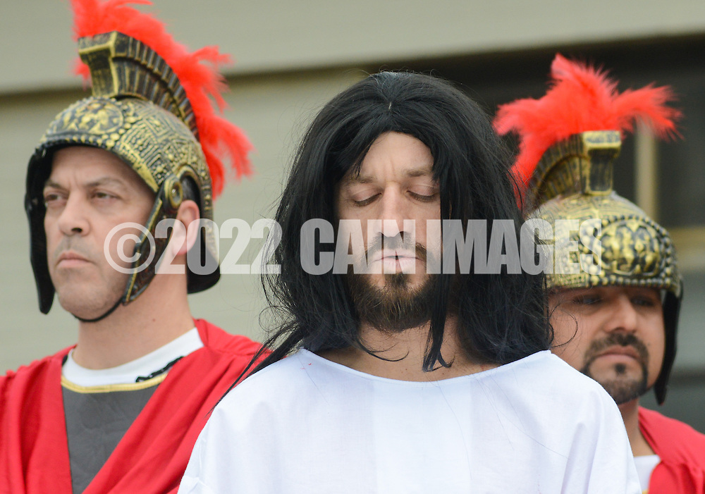 Roberto Marquez, of Bensalem, Pennsylvania portrays Jesus as he walks through the Stations of the Cross leading to his crucifixion on Good Friday April 3, 2015 at Our Lady of Fatima in Bensalem, Pennsylvania.  (Photo by William Thomas Cain/Cain Images)