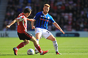 Callum Camps challenges George Honeyman during the EFL Sky Bet League 1 match between Sunderland and Rochdale at the Stadium Of Light, Sunderland, England on 22 September 2018.