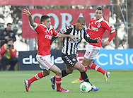 Portugal, FUNCHAL : Benfica's Uruguayan midfielder Urreta(L )  vies withNacional´s Brazilian defender Claudemir(r) during Portuguese League football match Nacional vs Benfica at Madeira Stadium in Funchal on February 10, 2013. PHOTO/ GREGORIO CUNHA..