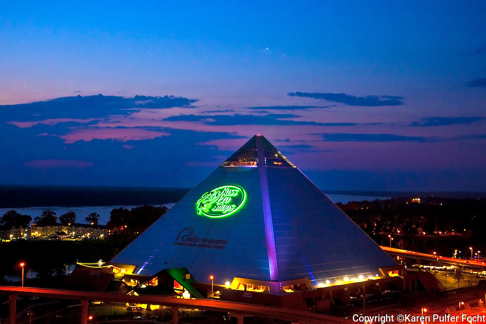 The Pyramid in Memphis Tennessee which is home to Bass Pro Shop, which opened this spring in Memphis near the Mississippi River. Ducks Unlimited Waterfowling Heritage Center, Big Cypress Lodge, Beretta Fine Gun Center, 28-Story Freestanding Glass Elevator, The Lookout at the Pyramid, Uncle Buck's Fishbowl and Grill, Cypress Swamp Waterfowl Habitat. It is one of the largest retail stores in the world. Visitors can ride the tallest, freestanding elevator in America — 28 stories to the top of the Pyramid and take in the view of the Mississippi River and downtown Memphis.