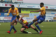 Krystian Pearce, Brian Graham and Hayden White  during the EFL Sky Bet League 2 match between Mansfield Town and Cheltenham Town at the One Call Stadium, Mansfield, England on 20 January 2018. Photo by Antony Thompson.