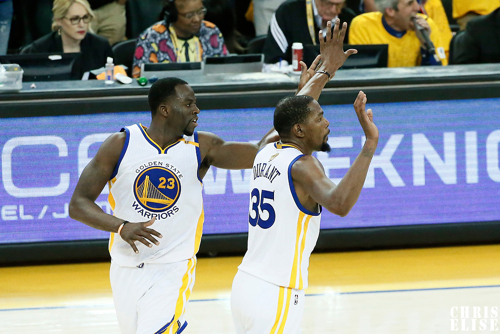 12 June 2017: Golden State Warriors forward Draymond Green (23) celebrates with Golden State Warriors forward Kevin Durant (35) during the Golden State Warriors 129-120 victory over the Cleveland Cavaliers, in game 5 of the 2017 NBA Finals, at the Oracle Arena, Oakland, California, USA.