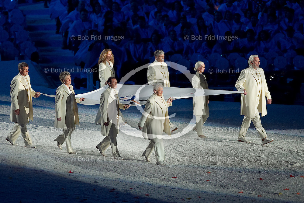 12 February 2010: Flag bearers Betty Fox, Barbara Ann Scott-King, Romeo Dallaire, Julie Payette, Bobby Orr, Anne Murray, Jacques Villeneuve, and Donald Sutherland, bring out the Olympic flag during the Opening Ceremony of the XXI Olympic Winter Games, the Vancouver 2010 Winter Olympics, held in BC Place Stadium  in Vancouver,  British Columbia, Canada..