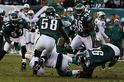 PHILADELPHIA - NOVEMBER 18: Trent Cole #58 and Brodrick Bunkley #97 of The Philadelphia Eagles make a tackle during the game against the Miami Dolphins on November 18, 2007 at Lincoln Financial Field in Philadelphia, Pennsylvania.