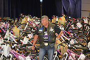 "Thin Blue Line President Rico Garcia with the ""Bikes for Excellence."""