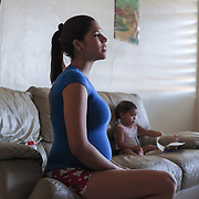 Kimberly Torres, 21, at her home near Guayama, Puerto Rico, is pregnant with her second child. Right now, Zika is spreading rapidly in Puerto Rico and pregnant women are at risk for becoming infected with Zika which can cause microcephaly and other birth defects. If the current trends continue, at least 1 in 4 people, including women who become pregnant, may become infected with Zika.