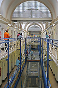 Prisoners socialise outside their cells on the balconies of A wing at Wandsworth prison. HMP Wandsworth in South West London was built in 1851 and is one of the largest prisons in Western Europe. It has a capacity of 1456 prisoners.
