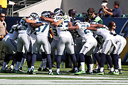 The Seattle Seahawks form a group and huddle before the 2017 NFL week 1 preseason football game against the against the Los Angeles Chargers, Sunday, Aug. 13, 2017 in Carson, Calif. The Seahawks won the game 48-17. (©Paul Anthony Spinelli)