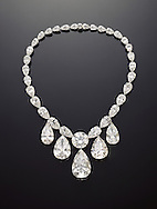 Large white pear shaped diamond necklace with one large round and 4 large pear shaped drop diamonds