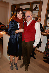 CAMILLA GUINNESS and GERRY FARRELL at a reception to launch Prestat's special edition of their award-winning chocolate bars to raise money for the charity Walking with the Wounded held at Sladmore Gallery, Bruton Place, London on 10th October 2013.