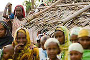 Refugee women from Central African Republic watch during a visit by UNICEF Goodwill Ambassador Mia Farrow in the village of Boulembe, near Bertoua, Cameroon, on Tuesday September 15, 2009.