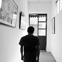 CHINA : PUNKS bw<br /> BEIJING - JUNE 2: Punk Xiao Rong leaveshis wife's art gallery on the outskirts in Beijing, June 2, 2004, in China. Five years after punk music was introduced to China, most bands dissolved in order to make money. Those few who are left, decisively want to be different from the mainstream although they are obliged to migrate from bar to bar as punk music usually does not draw a big audience. Although, punk is not popular, Xiao Rong and his band has toured the U.S., Japan and Europe and has recorded CD's in Japan. Looking back now, Xiao admits that his beginning in the late nineties when he spent his days nearby the Scream Bar were the worst days of his life and hopes not to repeat them. Although he prefers his image as an outsider, he is married and a proud father of a 2-year-old son.