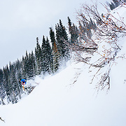 Silas Chickering-Ayers plays in blower storm powder in the backcountry of the Teton near Jackson Hole Mountain Resort, Teton Village, Wyoming.