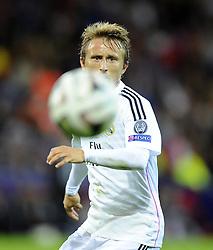 Real Madrid's Luka Modric watches the ball - Photo mandatory by-line: Joe Meredith/JMP - Mobile: 07966 386802 12/08/2014 - SPORT - FOOTBALL - Cardiff - Cardiff City Stadium - Real Madrid v Sevilla - UEFA Super Cup