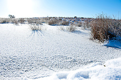 © Licensed to London News Pictures. 18/01/2015. A small pool is frozen on the high moorland of the Mynydd Epynt 400 metres above sea level. Mid Wales woke to sub zero temperatures and a beautiful blue sky. Mynydd Epynt, Powys , Wales, UK. Photo credit: Graham M. Lawrence/LNP
