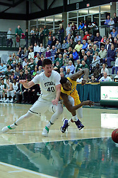 21 February 2017:  Alec Bausch and Chrishawn Orange dive for a loose ball after the ball is knocked down the court on a steel by Bausch during an College men's division 3 CCIW basketball game between the Augustana Vikings and the Illinois Wesleyan Titans in Shirk Center, Bloomington IL