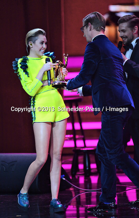 Miley Cyrus performs on stage at the Bambi Awards 2013 at Stage Theatre in Berlin, Germany, Thursday, 14th November 2013. Picture by  Schneider-Press / i-Images<br /> UK &amp; USA ONLY