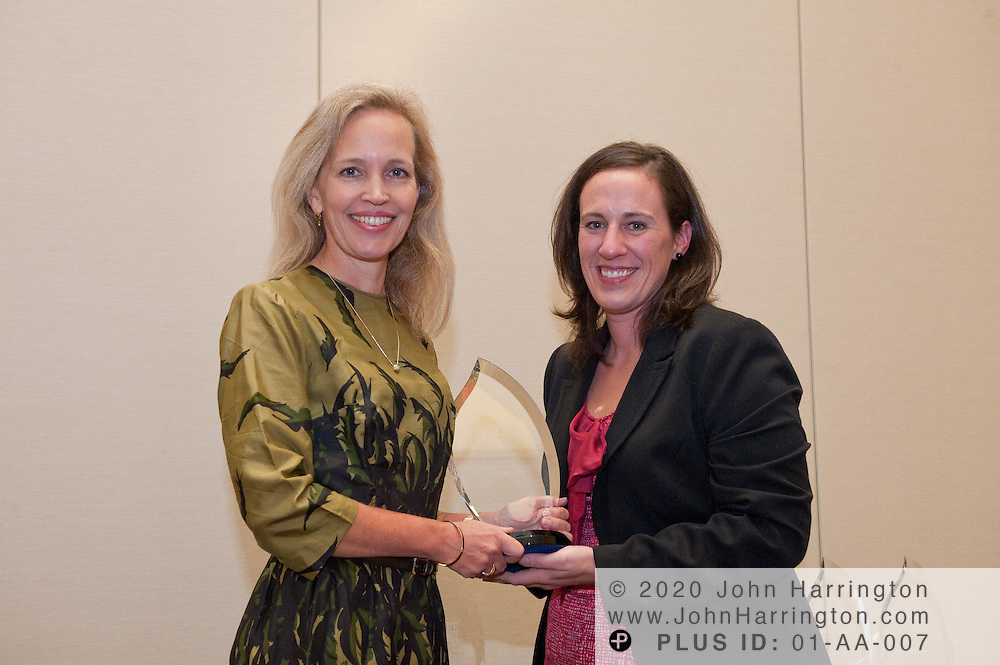 Janice Abraham (L), President and CEO, United Educators Insurance, a Reciprocal Risk Retention Group receives the WIL Honoree Award from Carrie Burns (R), Editor, INN at the Women in Insurance Leadership Forum at the National Harbor in Maryland on September 18th, 2011.