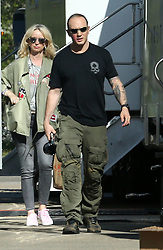 "EXCLUSIVE: Tom Hardy looks battered and bruised, as he is pictured on the set of Fonzo with fellow co-stars Linda Cardellini,Kyle MacLachlan and Noel Fisher for the first time. Hardy could be seen with red welts on his right cheek while sporting Al ""Scarface"" Capone's facial scars on the other cheek. 12 Apr 2018 Pictured: Tom Hardy. Photo credit: MEGA TheMegaAgency.com +1 888 505 6342"