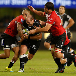 DURBAN, SOUTH AFRICA - APRIL 09: Lionel Mapoe and Warwick Tecklenburg of the Emirates Lions look to tackle Lourens Adriaanse of the Cell C Sharks during the 2016 Super Rugby match between Cell C Sharks and Emirates Lions at Growthpoint Kings Park on April 09, 2016 in Durban, South Africa. (Photo by Steve Haag/Gallo Images)