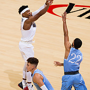 05 December 2018: San Diego State Aztecs guard Devin Watson (0) hits a three point shot over San Diego Toreros guard Isaiah Wright (22) in the first half. The Aztecs lost to the Toreros 73-61 at Viejas Arena.