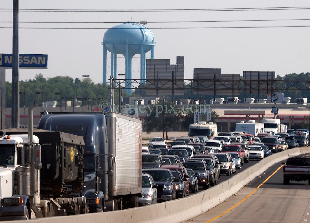 22 Sept 2005. New Orleans, Louisiana.  Hurricane Rita evacuation. <br /> Traffic backs up on the east bound Interstate 10 on the Louisiana/Texas border as residents ironically flee toward New Orleans away from the projected path of Hurricane Rita.<br /> Photo; &copy;Charlie Varley/varleypix.com