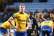 Bath scrum half Chris Cook (9) looks dejected at the end of the game during the Gallagher Premiership Rugby match between Wasps and Bath Rugby at the Ricoh Arena, Coventry, England on 2 November 2019.