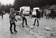 MUDTEK ravers with balloons in mud, Llanddewi Brefi, Wales 2016