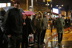 © Licensed to London News Pictures. 09/01/2017. London, UK. Soaked commuters look for alternative routes outside Waterloo Station in the rain as London Underground services are severely disrupted due to RMT and TSSA unions' 24-hour strike action in a dispute over jobs cuts and closed ticket offices on January 9, 2017. Photo credit: Tolga Akmen/LNP