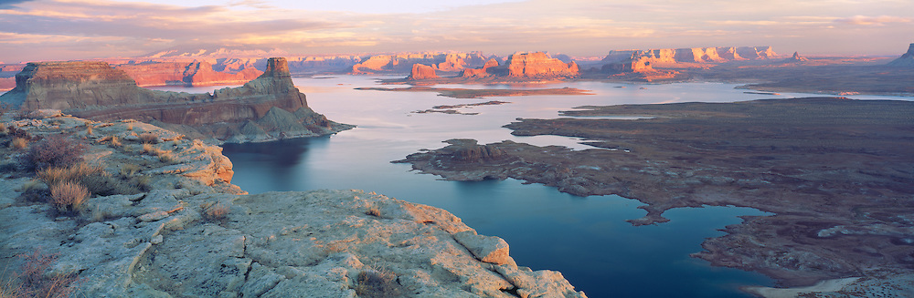 0306-1000B ~ Copyright: George H. H. Huey ~ Padre Bay with Gunsight Butte [near left], and Navajo Mountain in distance in clouds. Sunset. Lake Powell. Glen Canyon National Recreation Area, Utah.