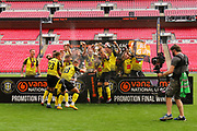 Harrogate Town players celebrate after theVanarama National League Promotion Final match between Harrogate Town and Notts County at Wembley Stadium, London, England on 2 August 2020.
