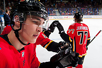 PENTICTON, CANADA - SEPTEMBER 10: Adam Ruzicka #63 of Calgary Flames stands on the bench and congratulates teammates on a goal against the Vancouver Canucks on September 10, 2017 at the South Okanagan Event Centre in Penticton, British Columbia, Canada.  (Photo by Marissa Baecker/Shoot the Breeze)  *** Local Caption ***