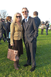 MIKE & ANGIE RUTHERFORD at the 2014 Hennessy Gold Cup at Newbury Racecourse, Newbury, Berkshire on 29th November 2014.  The Gold Cup was won by Many Clouds ridden by Leighton Aspell.
