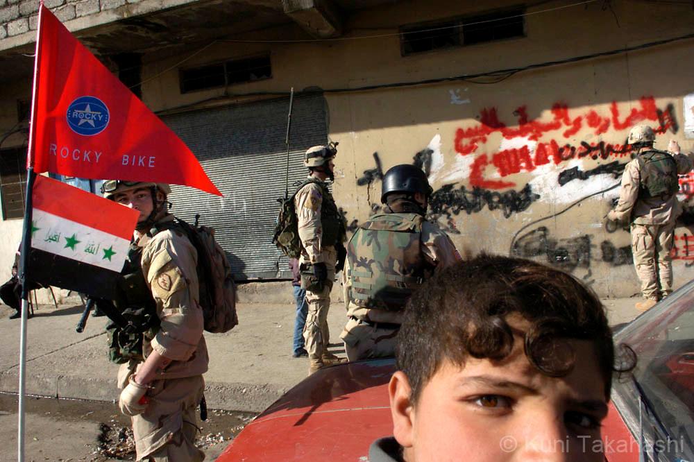 U.S soldiers erase anti-U.S graffiti in Mosul, Feb 2005.
