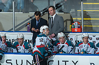 KELOWNA, CANADA - FEBRUARY 20: Kelowna Rockets' coaches Travis Crickard and Jason Smith stand on the bench during a time out against the Prince George Cougars  on February 20, 2018 at Prospera Place in Kelowna, British Columbia, Canada.  (Photo by Marissa Baecker/Shoot the Breeze)  *** Local Caption ***