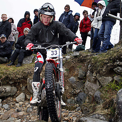 Adam Milner England  tries hard to negotiate the heavy boulders on the lagnaha section near duror in argyll.  The six day trial pits man and machine against the heavy highland terrain with the winner having he best times on each of the stages at the end of the six days. picture kevin mcglynn | STOCKPIX