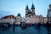 "A street perfomer dressed as a panda in-front of a crowd at Old Town Square. The ""Church of Our Lady before Týn"" in the back."