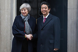 London, UK. 10th January, 2019. Prime Minister Theresa May and Japanese Prime Minister Shinzo Abe shake hands outside 10 Downing Street before talks. Subjects to be discussed will include the UK's latest arrangements for withdrawal from the European Union.